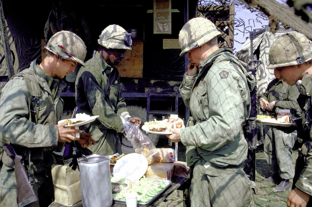 Infantrymen prepare their meals in a field mess during a combat training exercise