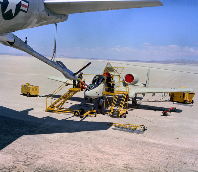 A YA-10 aircraft is refueled on the ground by a KC-135 Stratotanker aircraft
