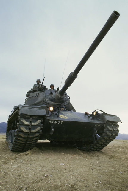 A US Army tank crew mans an M60 main battle tank during a field training exercise