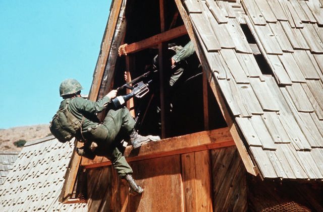 Marines conduct a house-to-house search during training