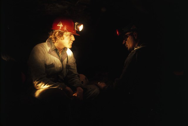 "Veteran Miner Harold Stanley, Right, Talks to a Young Miner Who has Come into the Mine for the First Time after 40 Hours of Classroom Training, Stanley Placed His Hand on the New Man, Shined His Lamp in the Miner's Face and Said ""Be Alert, Be Safe, and Uns (You) Will be a Good Miner and Get along Just Fine,"" this is Virginia-Pocahontas Coal Company Mine #3 Near Richlands, Virginia"