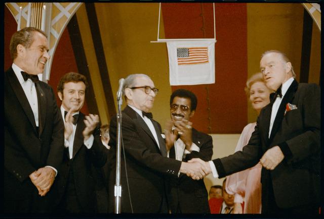 Comedian-Actor Bob Hop Shaking Songwriter Irving Berlin's Hand at the White House Dinner Held for Released Vietnam Prisoners of War while President Richard Nixon Looks On