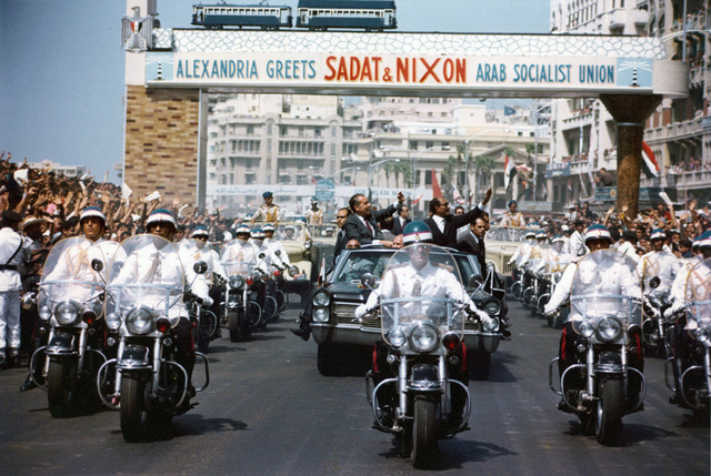 President Richard Nixon with Egyptian President Anwar Sadat, Waving from a Motorcade Driving through Alexandria, Egypt