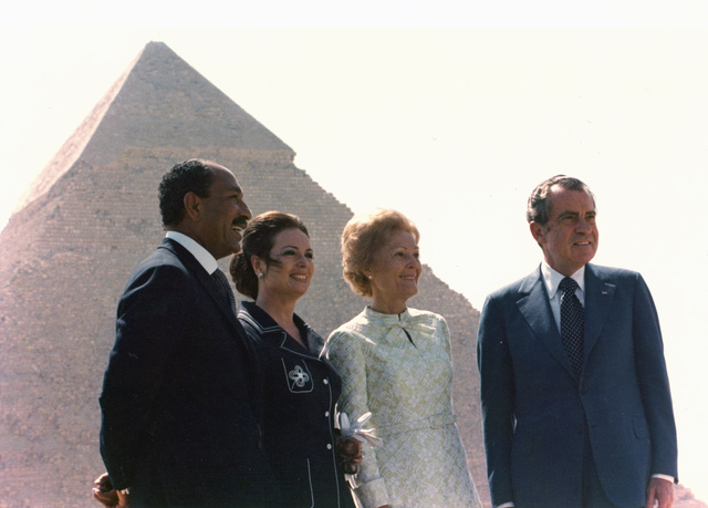 President Richard Nixon and Pat Nixon with President Anwar Sadat and Jehan Sadat at the Giza Necropolis Pyramids, the Great Pyramid of Khufu is Visible in the Background