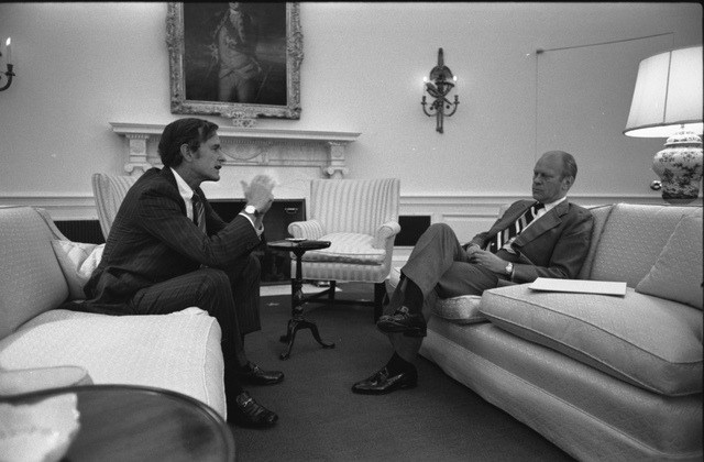 Photograph of President Gerald R. Ford Meeting with George H. W. Bush, Chairman of the Republican National Committee, in the Oval Office