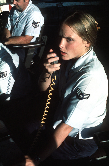 Ground controller SGT. Joyce Kaopuicki directs a departing aircraft from the control tower