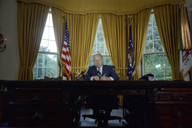 President Gerald R. Ford Signing a Proclamation Granting Pardon to Former President Richard Nixon in the Oval Office