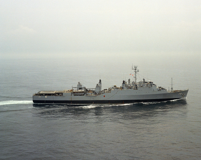 A starboard beam view of the amphibious transport dock USS PLYMOUTH ROCK (LSD 29) underway