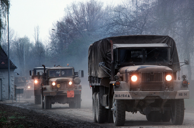 A U.S. Army M-35 cargo truck leads a convoy of vehicles