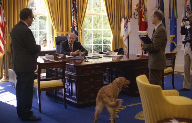 Photograph of President Gerald Ford Conferring with Secretary of State Henry Kissinger and National Security Advisor Brent Scowcroft in the Oval Office