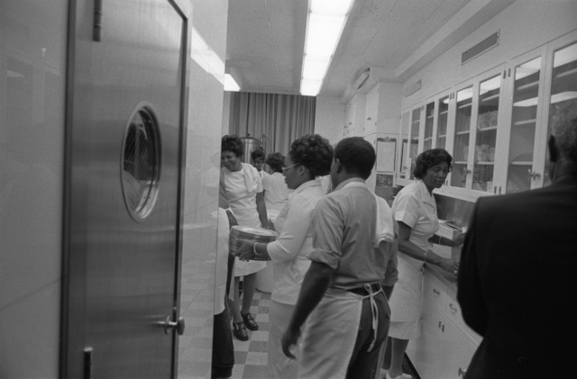 Photograph of White House Cooks and Support Staff Working in the State Floor Kitchen during a State Dinner Honoring First Secretary Edward Gierek of Poland