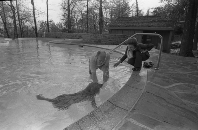 Photograph of President Gerald R. Ford and First Lady Betty Ford with their Dog Liberty at the Camp David Swimming Pool