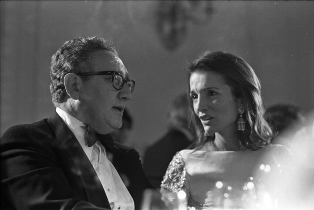 Photograph of Secretary of State Henry Kissinger and Lee Bouvier Radziwill, Sister of Jacqueline Kennedy Onassis, at a State dinner Honoring Chancellor Bruno Kreisky of Austria