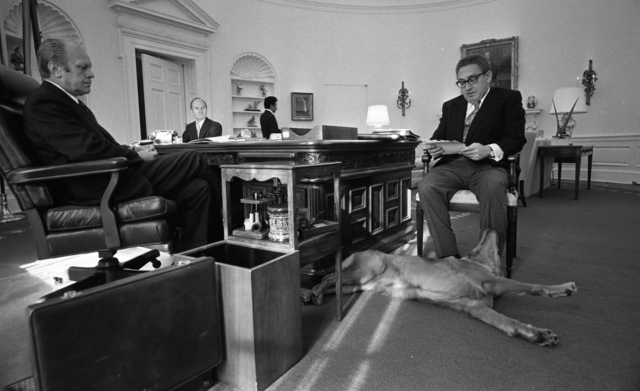 President Gerald R. Ford's Dog Liberty Lying at Henry Kissinger's Feet during a Meeting with President Ford and Brent Scowcroft in the Oval Office