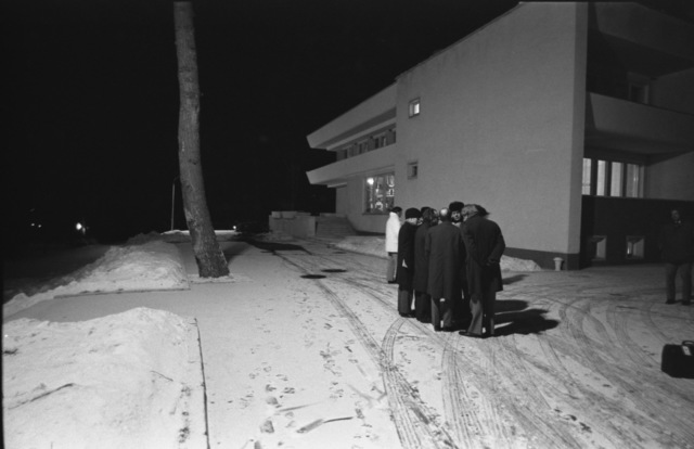 Photograph of President Gerald Ford and his Aides Discussing Negotiating Strategy Outdoors, in -20 Degree Weather, for Fear of being Electronically Monitored by Their Russian Hosts
