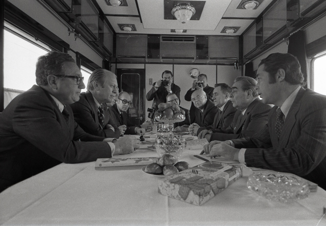 Photograph of President Gerald Ford, Secretary of State Henry Kissinger and Other U.S. Representatives Meeting with Soviet General Secretary Leonid Brezhnev, Foreign Secretary Andrei Gromyko, Soviet Ambassador Anatoly Dobrynin, and Others aboard a Soviet Train Headed for Vladivostok