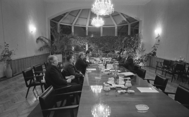 Photograph of President Gerald Ford, Soviet General Secretary Leonid Brezhnev, and Others Attending a Late Night Meeting that Extended into the Early Hours of November 24 at the Vladivostok Summit