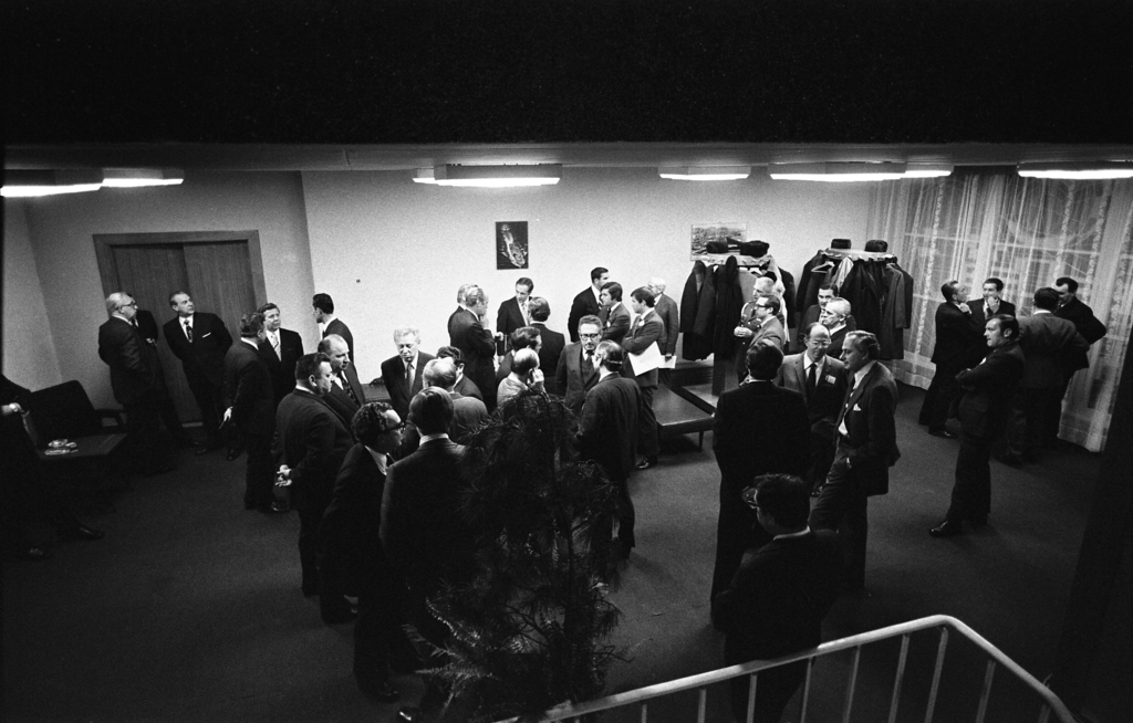 Photograph of the American and Soviet Delegations Taking a Break for Refreshments during a Long Nighttime Meeting at the Vladivostok Summit Meetings on Arms Control