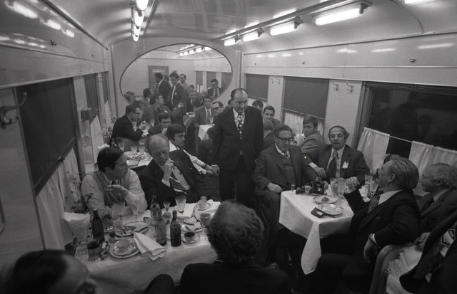 Photograph of President Gerald Ford and his Staff Dining on a Soviet Train en route to Vozdvizhenka Airport, near Vladivostok, U.S.S.R. following the Vladivostok Summit Meetings on Arms Control