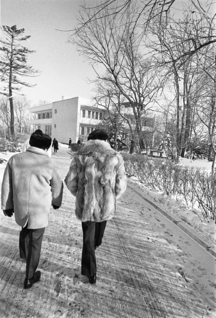 Photograph of President Gerald Ford and Secretary of State Henry Kissinger Walking to the Summit Meeting Room at Okeansky Sanatorium in Vladivostok, U.S.S.R.