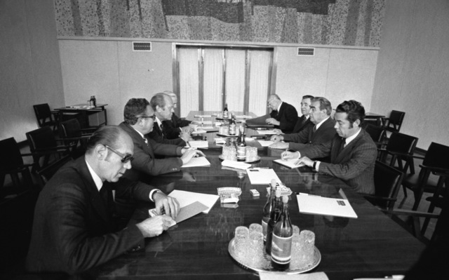 Photograph of President Gerald Ford, General Secretary Lenoid Brezhnev, and Others Attending a Meeting on the Second Day of the Vladivostok Summit Meetings on Arms Control