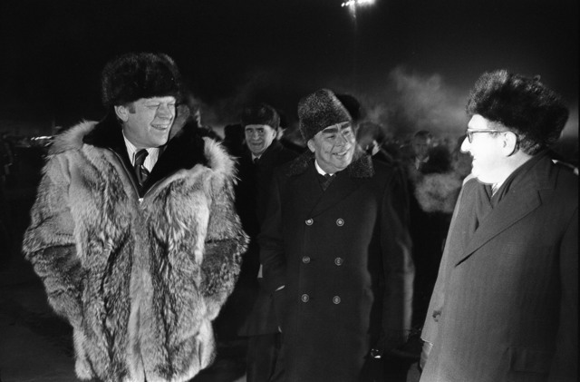 Photograph of President Gerald Ford, Secretary Leonid Brezhnev, and Henry Kissinger at the Conclusion of the Vladivostok Summit