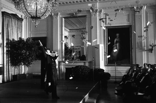 Photograph of Joel Grey Performing in the East Room during the Entertainment Portion of a State Dinner Honoring Chancellor Helmut Schimdt of the Federal Republic of Germany