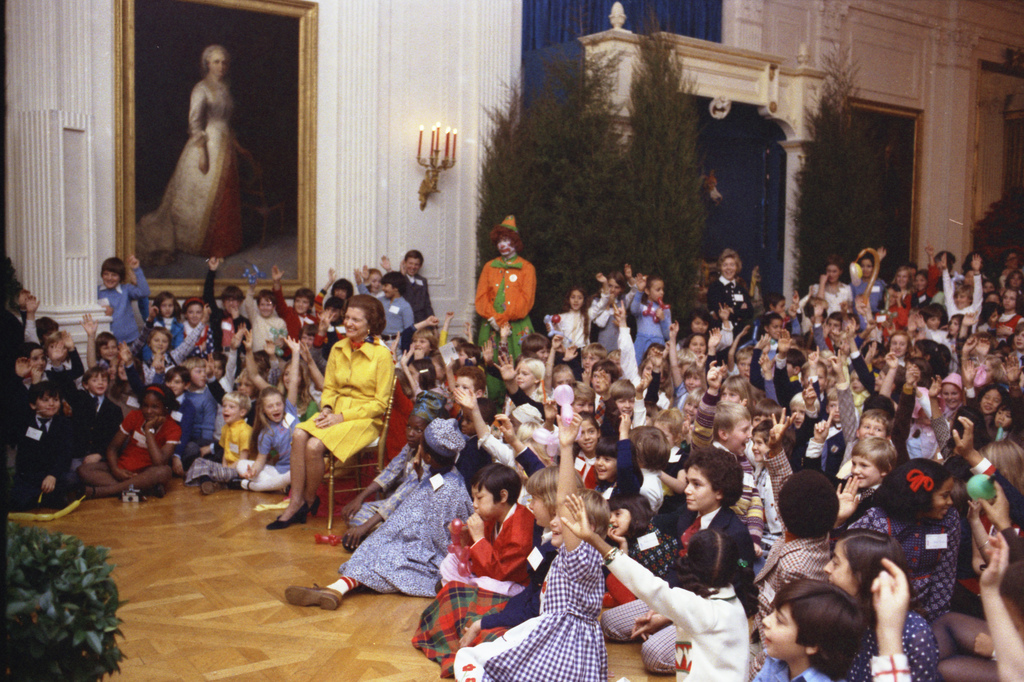 Photograph of First Lady Betty Ford and her Guests During a Christmas Party for the Children of Diplomats Assigned to Washington, DC, in the East Room of the White House