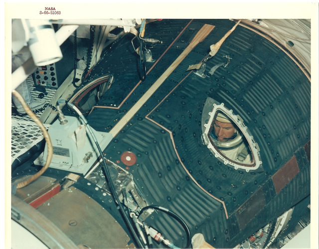 Photograph of Astronaut Cooper Sealed Inside the Cabin of the 30' Altitude Chamber