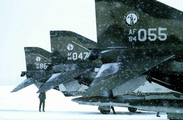 A view of tails of parked RF-4C Phantom II aircraft, from the Air National Guard, during Exercise Jack Frost '75