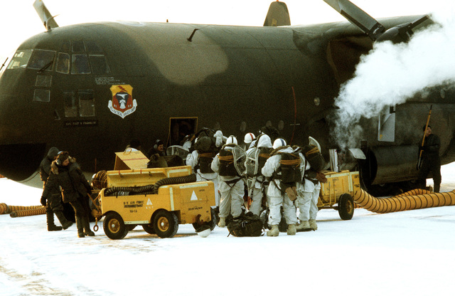 Army troops embark a C-130 Hercules aircraft during Exercise Jack Frost '75