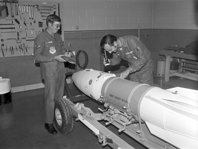 """U.S. Air Force personnel assigned to the 119th Fighter Wing""""Happy Hooligans"""", North Dakota Air National Guard inspect an inert rocker motor at Hector Field, North Dakota. (A3604) (U.S. Air Force PHOTO) (Released)"""