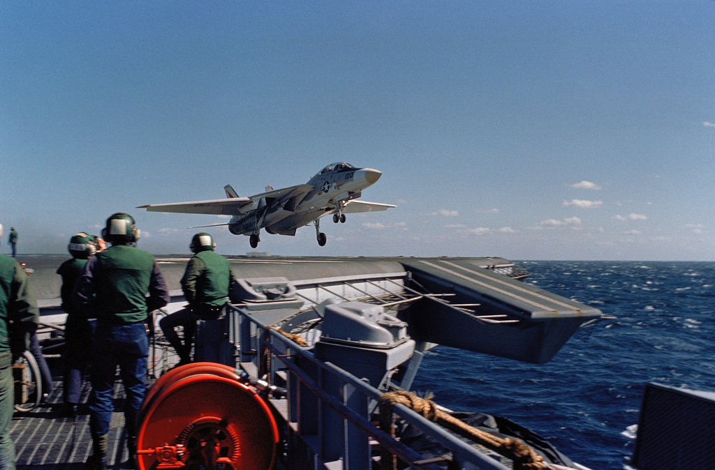 A Fighter Squadron 14 (VF-14) F-14 Tomcat aircraft clears the flight deck after a wave-off during flight operations aboard the aircraft carrier USS JOHN F. KENNEDY (CV 67)
