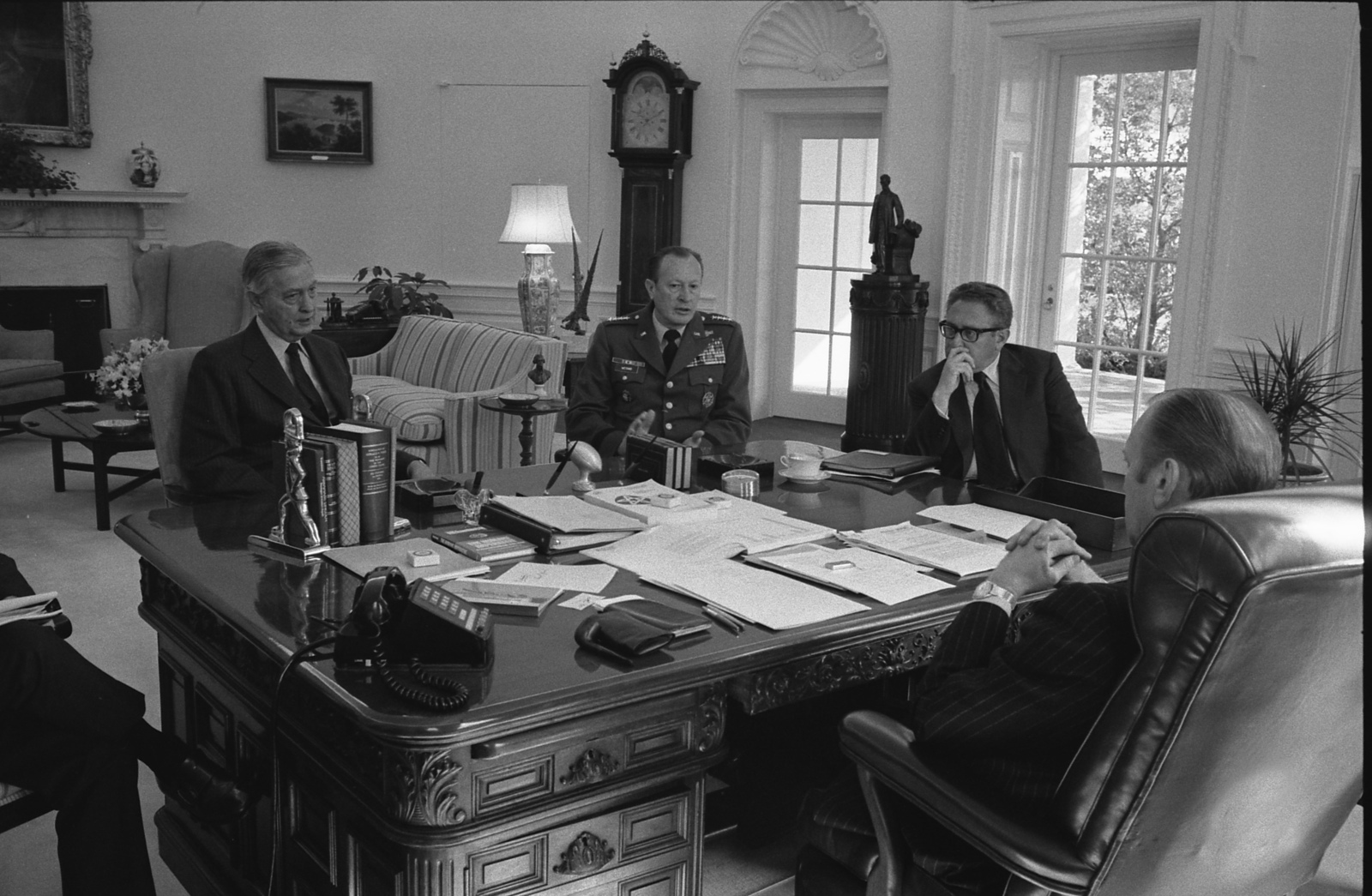 Photograph of President Gerald Ford Meeting with Brent Scowcroft, Graham Martin, General Frederick Weyand, and Henry Kissinger in the Oval Office to Discuss the Situation in Vietnam