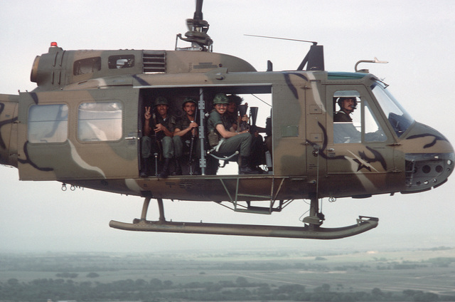 A UH-1 Iroquois helicopter is used to transport US Army troops during a training exercise
