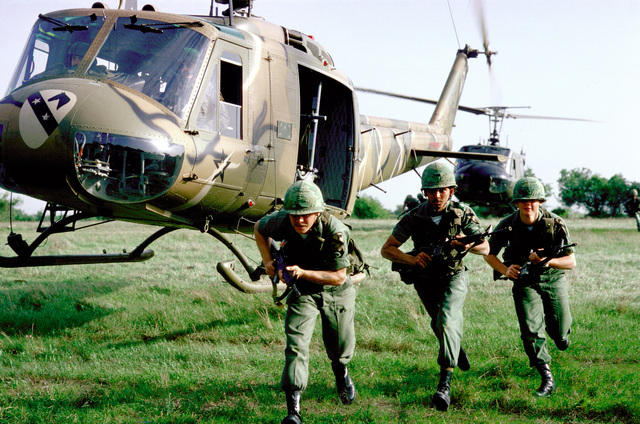Infantrymen move out after exiting UH-1 Iroquois helicopters during a field training exercise