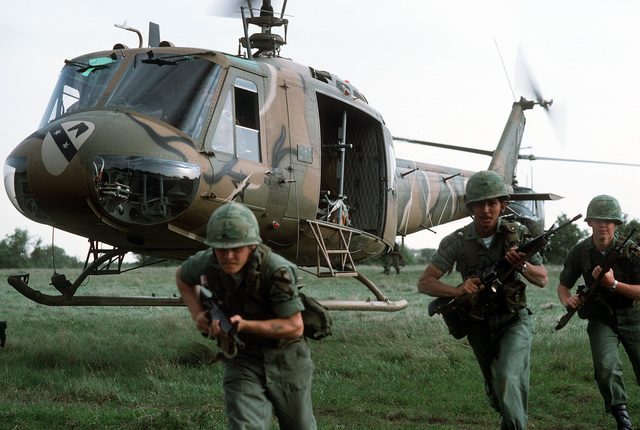 Members of the 1ST Cavalry Division deploy from UH-1H Iroquois helicopters during an exercise