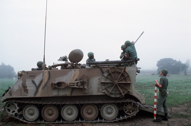 US Army soldiers man an M106 mortar carrier during a field training exercise