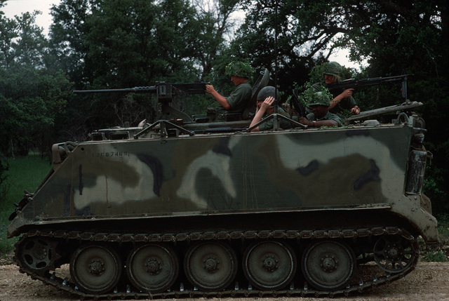 US Army soldiers man an M113A1 armored personnel carrier during a field training exercise