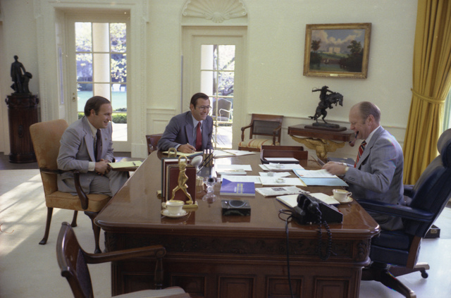 Photograph of President Gerald R. Ford Meeting with Chief of Staff Donald Rumsfeld and Dick Cheney in the Oval Office