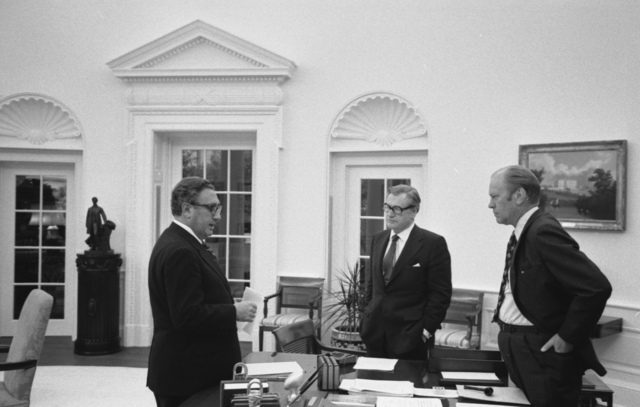 Photograph of President Gerald Ford Meeting in the Oval Office with Secretary of State Henry A. Kissinger and Vice President Nelson A. Rockefeller to Discuss the American Evacuation of Saigon