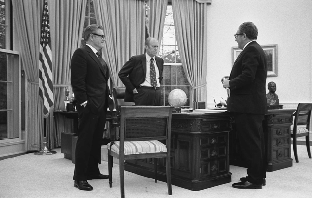 Photograph of President Gerald R. Ford Meeting in the Oval Office with Secretary of State Henry Kissinger and Vice President Nelson Rockefeller to Discuss the American Evacuation of Saigon