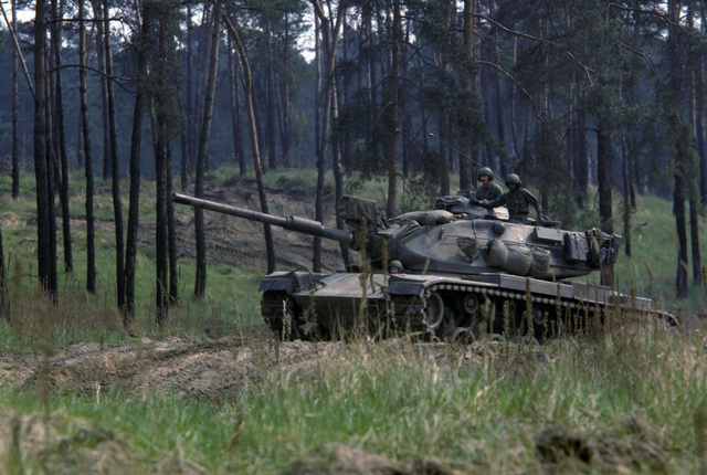 US Army soldiers operate an M60 main battle tank during a field training exercise