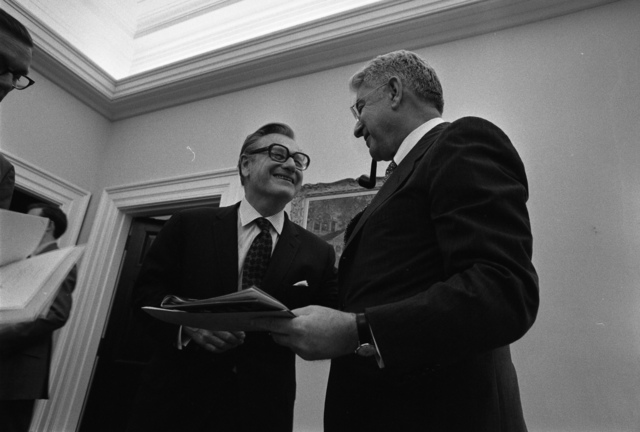 Photograph of Vice President Nelson A. Rockefeller and Chairman of the Federal Reserve Board Arthur Burns Talking outside of the Cabinet Room