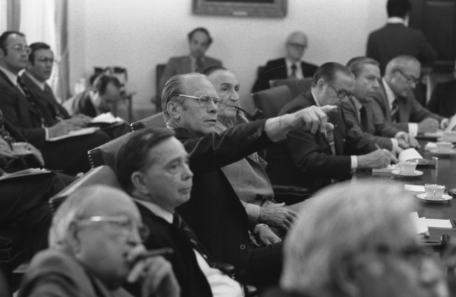 President Ford Points to a Map of the Cambodian Coastal Area during a Presentation by Secretary of State Henry Kissinger at a May 14, 1975 Briefing on the SS Mayaguez Situation for the Bipartisan Congressional Leadership