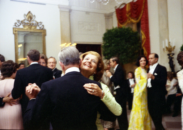 Photograph of First Lady Betty Ford and Fred Astaire Dancing at a State Dinner Honoring the Shah of Iran