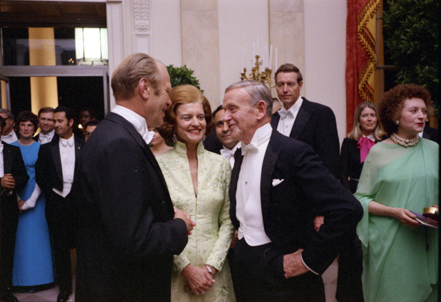 Photograph of President Gerald R. Ford and First Lady Betty Ford Talking with Fred Astaire at a State Dinner Honoring the Shah of Iran