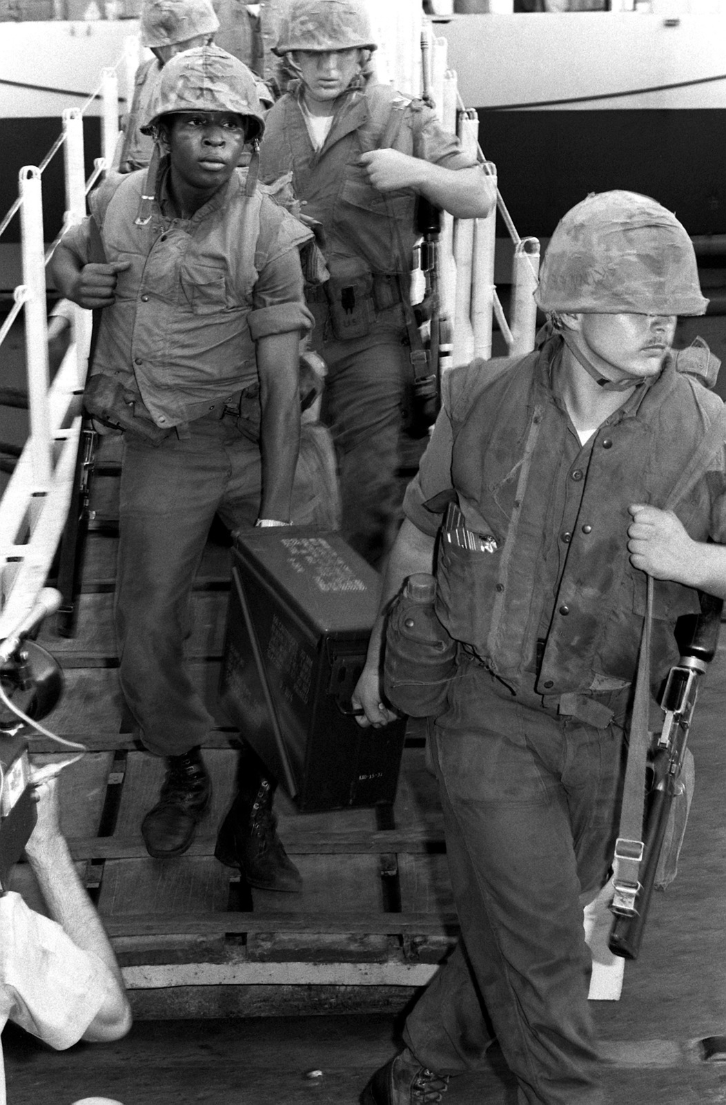 U.S. Marines from Co. G and Co. E, 2nd Bn., 9th Marines, depart the aircraft carrier USS CORAL SEA (CV-43) following the rescue operation of the merchant vessel SS MAYAGUEZ and the Kon Tang Island Operation