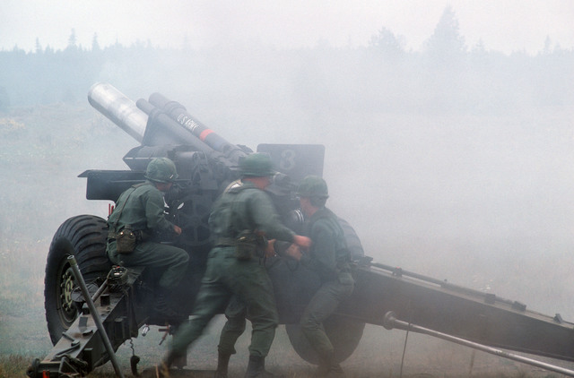 An M114 155 mm howitzer in operation during a training exercise