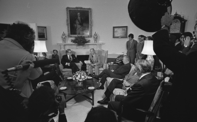 Photograph of President Gerald R. Ford Receiving the Report of the Commission on C.I.A. Activities within the United States (Rockefeller Commission) from Vice President Nelson A. Rockefeller and the Committee Members